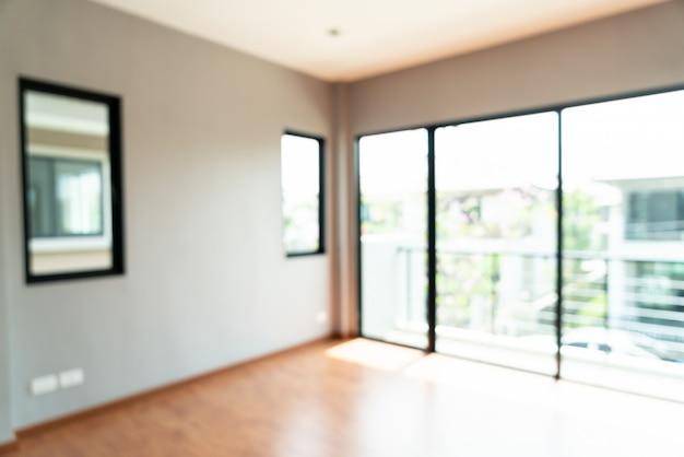 Flou abstrait chambre vide avec fenêtre et porte dans la maison Photo Premium