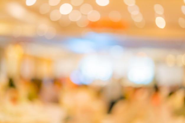 Flou abstrait de la fête de mariage dans la grande salle Photo Premium