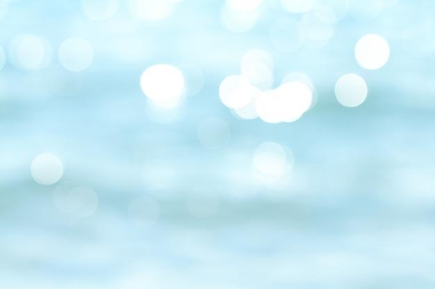 Flou de la plage tropicale avec la lumière du bokeh sur fond abstrait vague Photo Premium