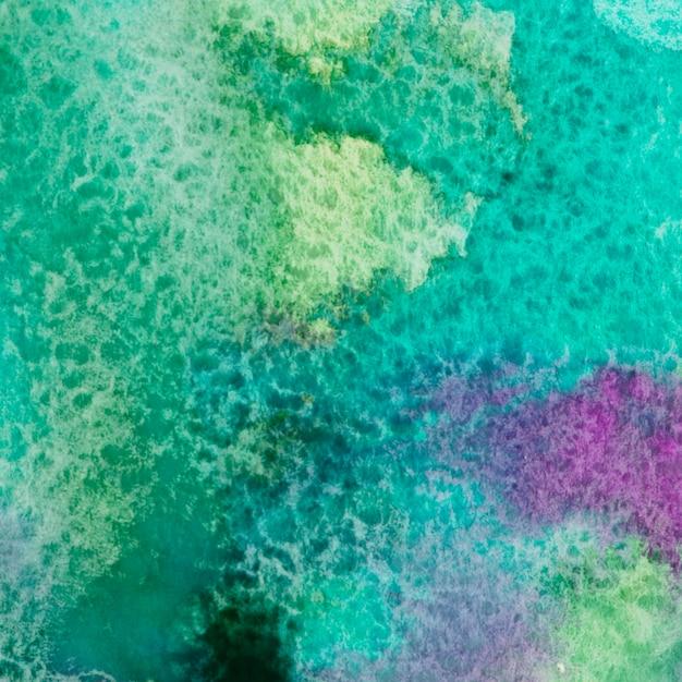 Fond artistique de texture aquarelle colorée Photo gratuit