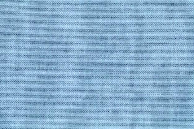 Fond bleu clair d'un matériau textile avec motif en osier, gros plan. Photo Premium