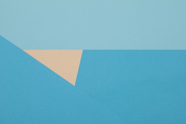 Fond Bleu Et Jaune, Le Papier Coloré Se Divise Géométriquement En Zones Photo Premium