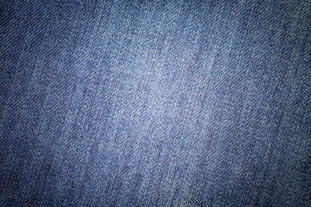 Fond bleu jeans. texture denim classique. surface de vêtements de mode. Photo Premium