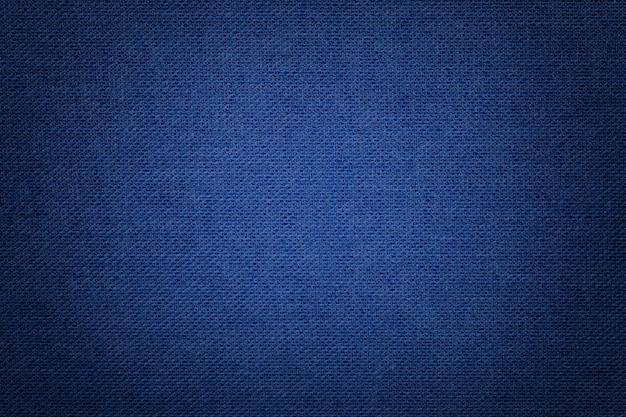 Fond bleu marine en textile avec motif en osier, agrandi. Photo Premium