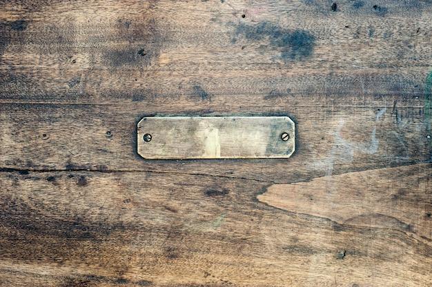 Fond en bois avec étiquette en métal Photo Premium