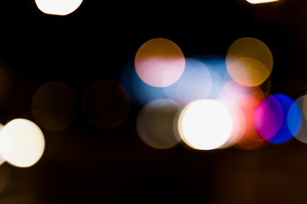 Fond de bokeh abstrait coloré sur fond sombre Photo gratuit