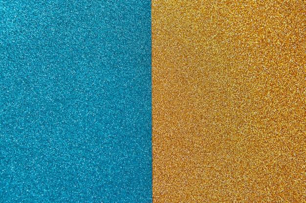 Fond brillant lumineux et festif, composé de deux moitiés, bleu et or. horizontal. Photo Premium