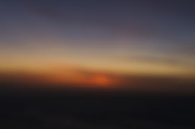Fond de ciel coucher de soleil flou Photo Premium