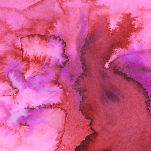 Fond de coups de pinceau peinture aquarelle rouge et rose Photo gratuit