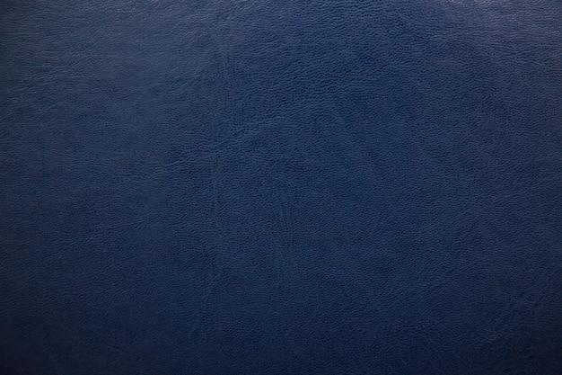 Fond en cuir texturé bleu foncé. Photo Premium