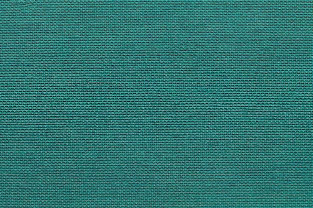 Fond cyan clair d'un matériau textile avec motif en osier, agrandi. Photo Premium