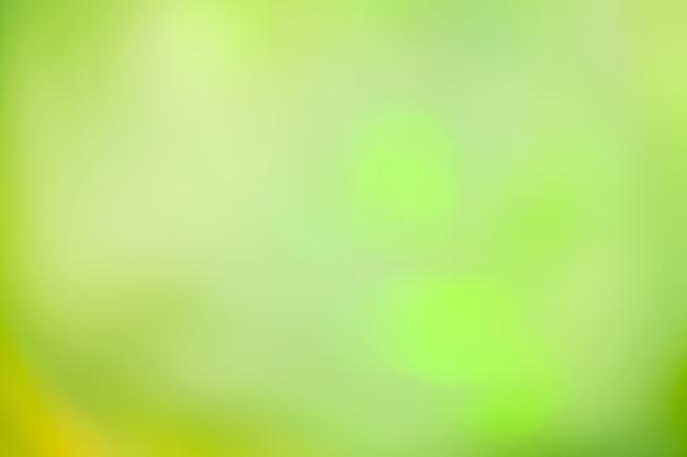 Fond défocalisé feux verts. fond de bokeh de paillettes vertes. Photo Premium