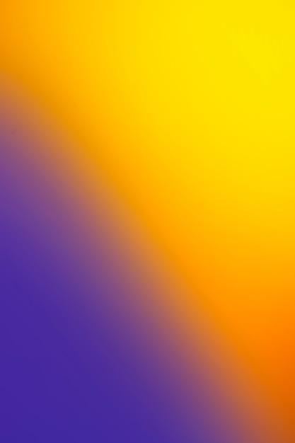 Fond dégradé de jaune et violet Photo gratuit