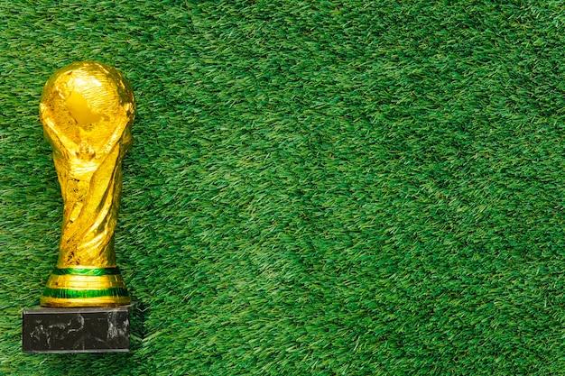 Fond de football avec trophée et copyspace Photo gratuit