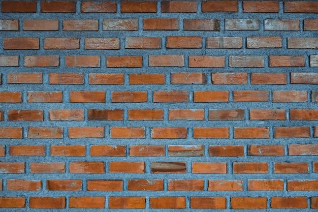 Fond de fragment de mur de brique rouge ou couche de brique bâtiment texture. Photo Premium