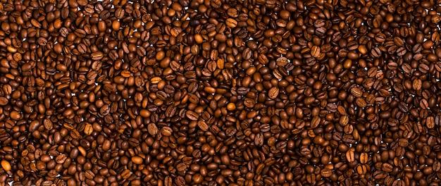 Fond De Grains De Café Torréfiés. Fermer Photo Premium