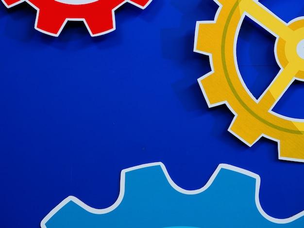 Fond de grandes roues dentées moteur roues bleues, arrière-plan industriel Photo Premium