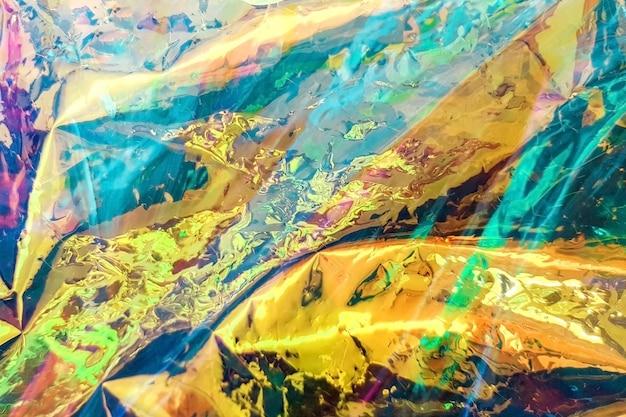 Fond holographique abstrait clair, texture. toile de fond tendance Photo Premium