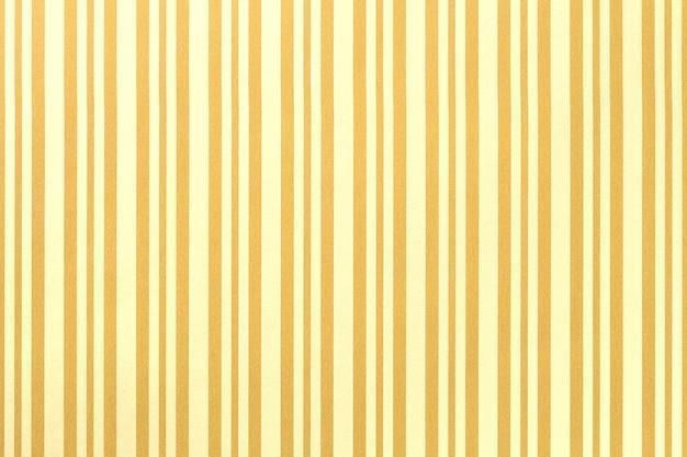 Fond jaune clair et doré de papier d'emballage rayé, Photo Premium
