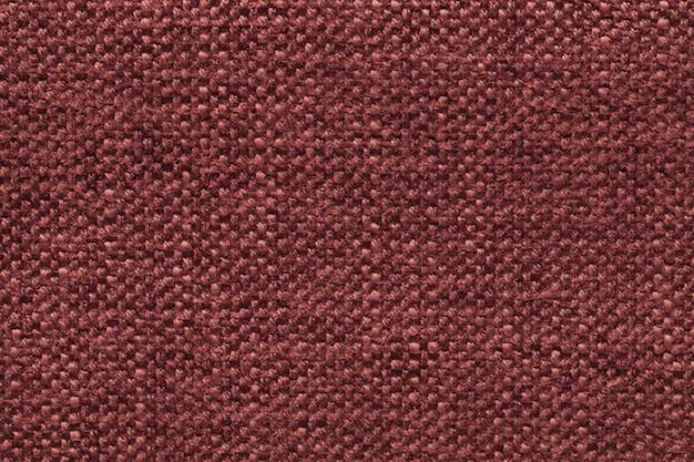 Fond en laine tricoté rouge foncé avec un motif de tissu doux et moelleux. texture du textile agrandi. Photo Premium