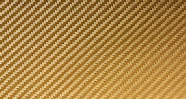 Fond de matière première composite de fibre de carbone d'or Photo Premium