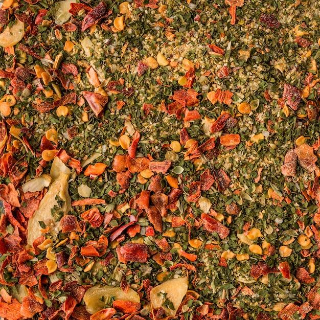 Fond de mélange d'herbes et d'épices, aliments biologiques, mode de vie sain Photo Premium