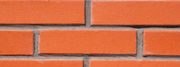 Fond de mur de brique rouge pour la conception. les briques sont liées par du mortier de ciment. Photo Premium