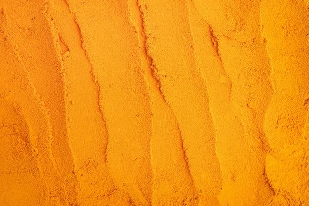 Fond de nature texture curcuma poudre Photo Premium