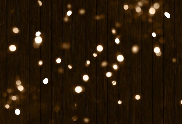 Fond de noël 3d avec des lumières de bokeh sur la texture en bois Photo gratuit