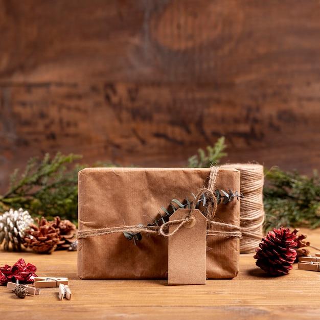 Fond de noël avec un cadeau mystérieux Photo gratuit
