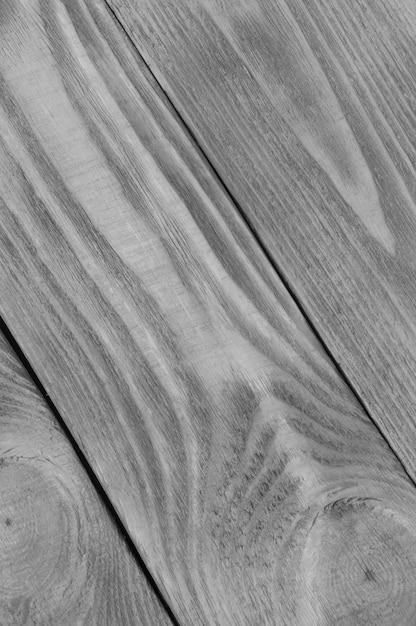Fond noir et blanc à partir de planches texturées en bois clair disposées en diagonale Photo Premium