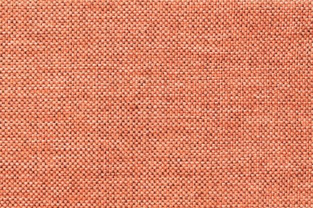Fond orange clair de tissu d'ensachage tissé dense du textile Photo Premium