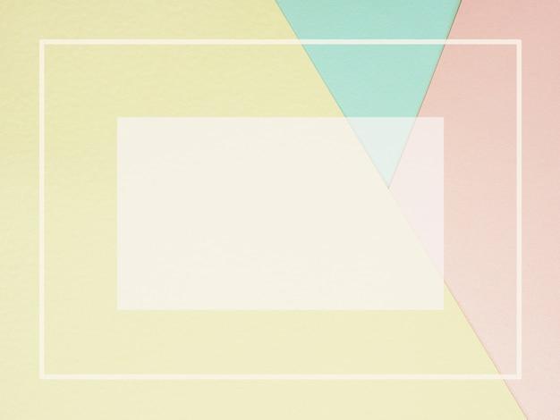 Fond de papier de couleur abstrait géométrique en rose pastel jaune et bleu avec cadre vide Photo Premium