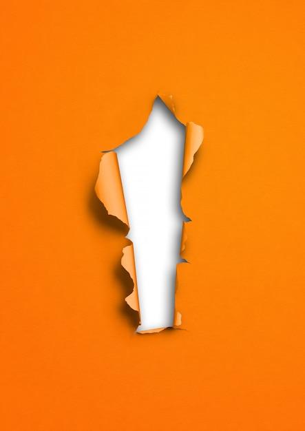 Fond De Papier Déchiré Orange Avec Trou Photo Premium