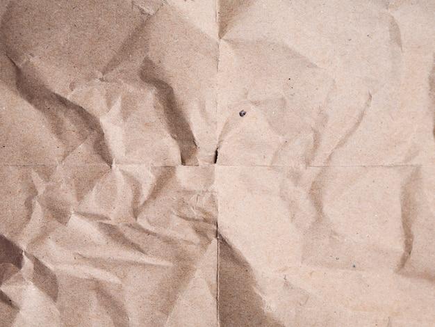 Fond de papier froissé beige Photo gratuit