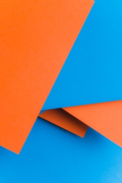 Fond de papier recyclé en bleu et orange Photo gratuit