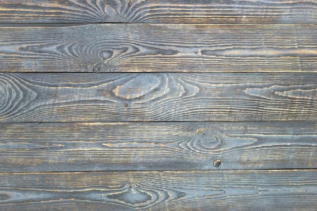 Fond de planches de texture en bois avec des restes de peinture grise. horizontal. Photo Premium