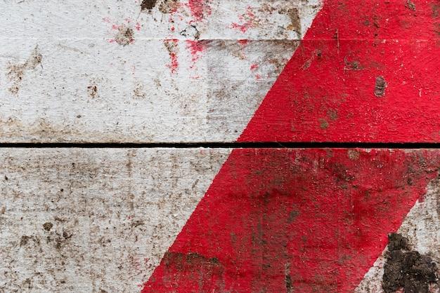 Fond de texture en bois avec une tache rouge Photo gratuit