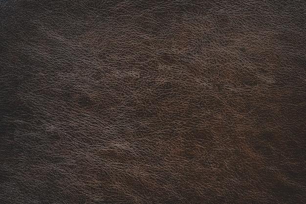 Fond de texture en cuir marron simple avec dégradé de lumière utilisé comme toile de fond classique de luxe Photo Premium