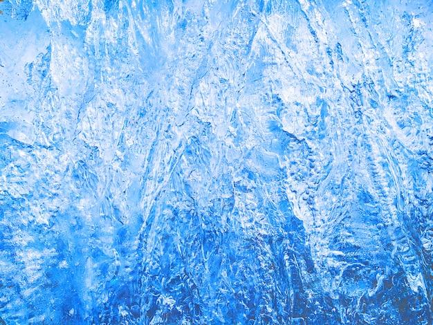 Fond Texturé De Glace Bleue Avec Une Surface Rugueuse. Eau Glacée Avec Cristaux Photo Premium