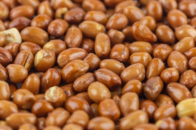 Fond de texture gros tas de cacahuète. Photo Premium