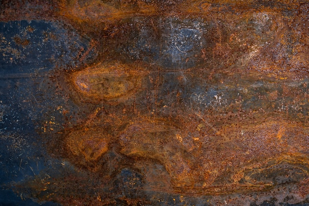 Fond de texture en métal rouillé foncé usé. Photo Premium