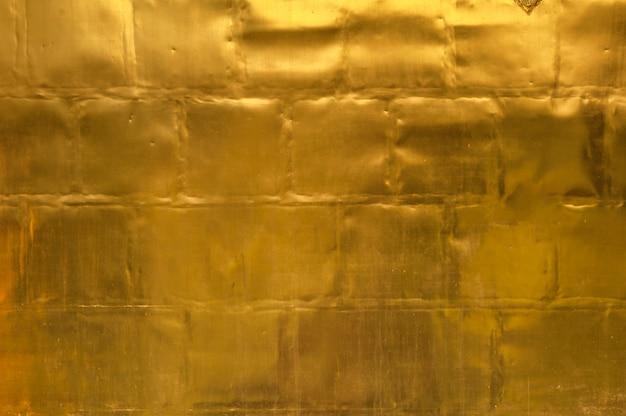 Fond de texture mur doré Photo Premium