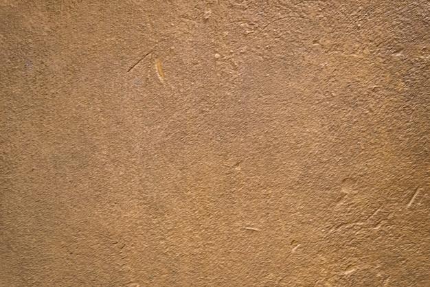 Fond De Texture De Mur De Plâtre Brun Doré Flou Photo Premium