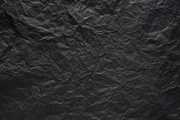 Fond de texture de papier froissé noir.   Télécharger des Photos Premium