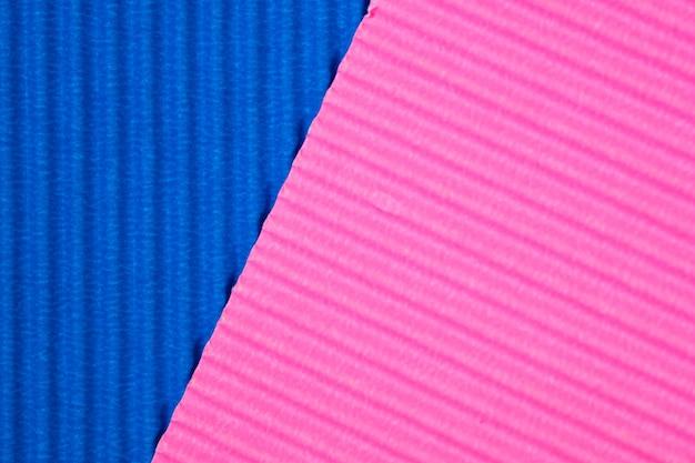 Fond de texture de papier ondulé bleu et rose. Photo Premium