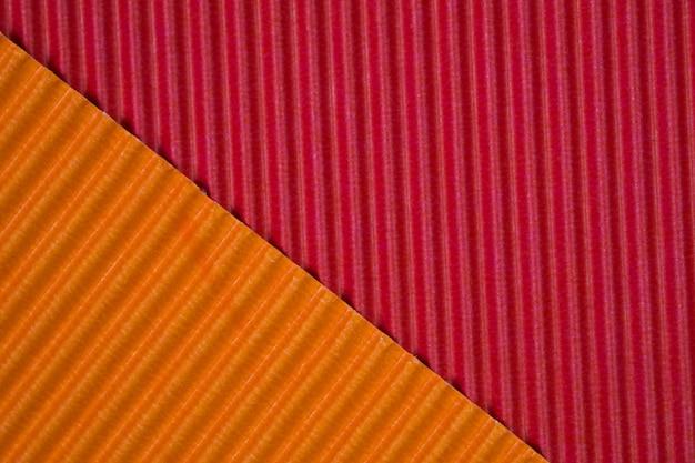 Fond de texture de papier ondulé rouge et orange Photo Premium