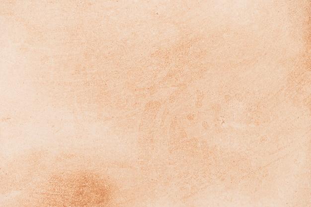 Fond de texture de surface en marbre orange clair Photo gratuit