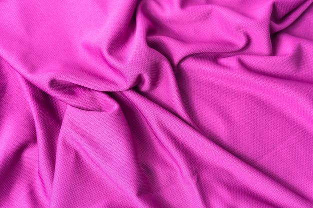 Fond Texturé En Tissu Rose. Maillot De Sport En Tissu Rose Avec Des Vêtements Texturés. Photo Premium
