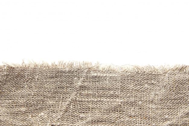 Fond et texture de toile de lin grossière grise avec un tissage serré et une frange le long du bord Photo Premium